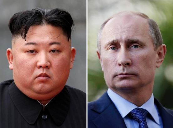A combination of file photos shows North Korean leader Kim Jong Un and Russia's President Vladimir Putin