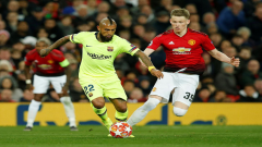 Barcelona's Arturo Vidal in action with Manchester United's Scott McTominay