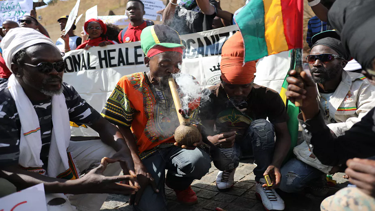 Rastafarians celebrate after the South African Constitutional Court ruled that the personal use of marijuana is now legal.