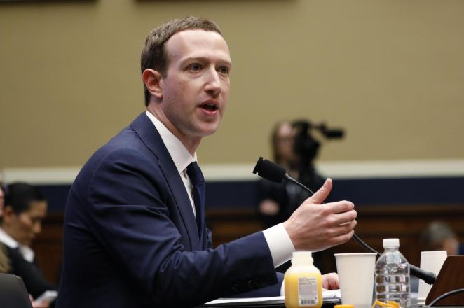 Facebook CEO Mark Zuckerberg testifies before a House Energy and Commerce Committee hearing regarding the company's use and protection of user data on Capitol Hill.