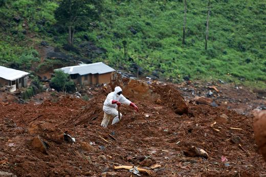 A rescue worker is seen at the scene of the mudslide in the mountain town of Regent.