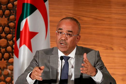 Algeria's newly appointed prime minister, Noureddine Bedoui, speaks during a joint news conference with deputy prime minister.