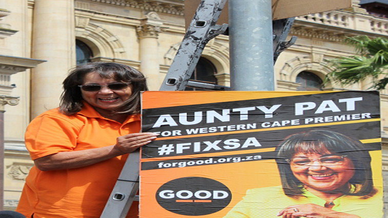 Patricia De Lille holding a poster