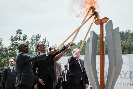 African Union chief Moussa Faki, Rwanda's President Paul Kagame, his wife Jeannette (2ndR), and European Commission President Jean-Claude Juncker light a remembrance flame for the 25th Commemoration of the 1994 Genocide at the Kigali Genocide Memorial in Kigali.