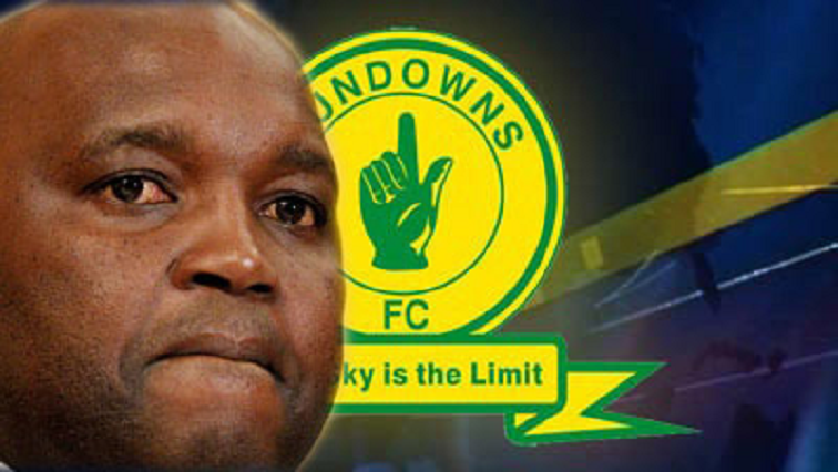 Pitso Mosimane and the Sundowns logo