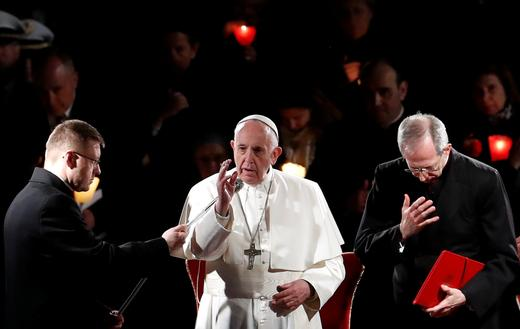 Pope Francis leads the Via Crucis (Way of the Cross) procession during Good Friday celebrations at Rome's Colosseum, Rome.
