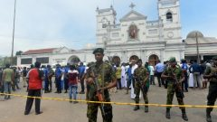 Sri Lankan security personnel keep watch outside the church