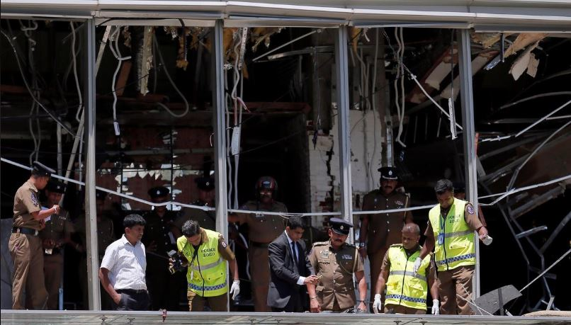 Crime scene officials inspect the explosion area at Shangri-La, Colombo.
