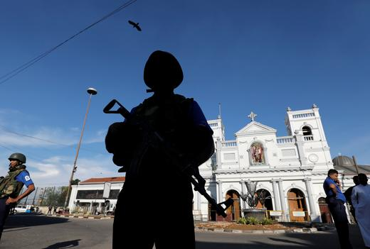 A security officer in front of a hotel in Sri Lanka