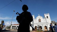 A security officer stands guard in front of St Anthony's shrine in Colombo, after bomb blasts ripped through churches and luxury hotels.