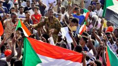 Sudanese holding flags