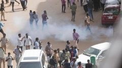 Tear gas is fired at Sudanese demonstrators during an anti-government protest in Khartoum.