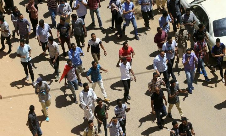 Sudanese demonstrators chant slogans during a protest demanding Sudanese President Omar Al-Bashir to step down in Khartoum, Sudan.