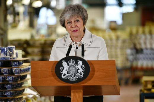 British Prime Minister Theresa May delivers a speech during a visit to the Portmeirion factory in Stoke-on-Trent.