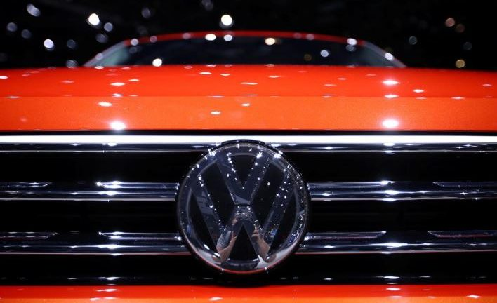 A Volkswagen logo is seen on a new car model at the 89th Geneva International Motor Show in Geneva.