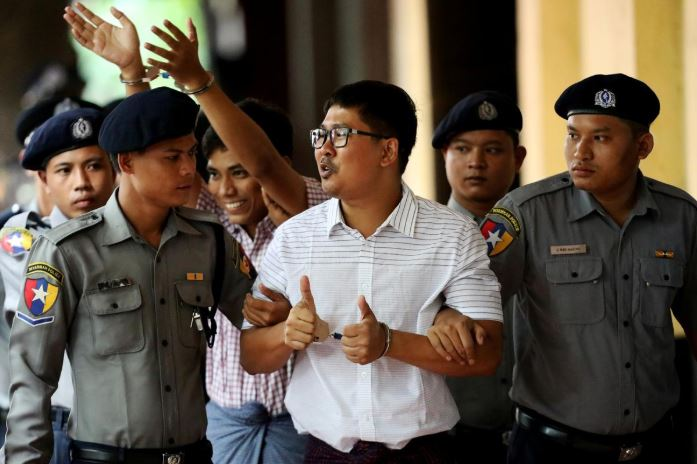 Detained Reuters journalists Wa Lone and Kyaw Soe Oo arrive at Insein court in Yangon.