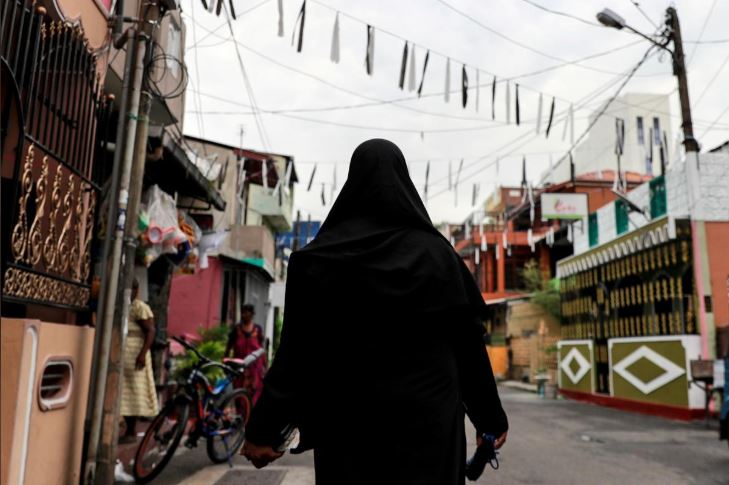 A Muslim woman wearing a hijab walks through a street near St Anthony's Shrine, days after a string of suicide bomb attacks across the island on Easter Sunday, in Colombo, Sri Lanka.