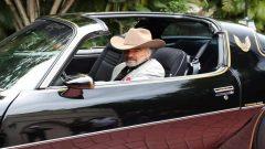 Burt Reynolds in his car