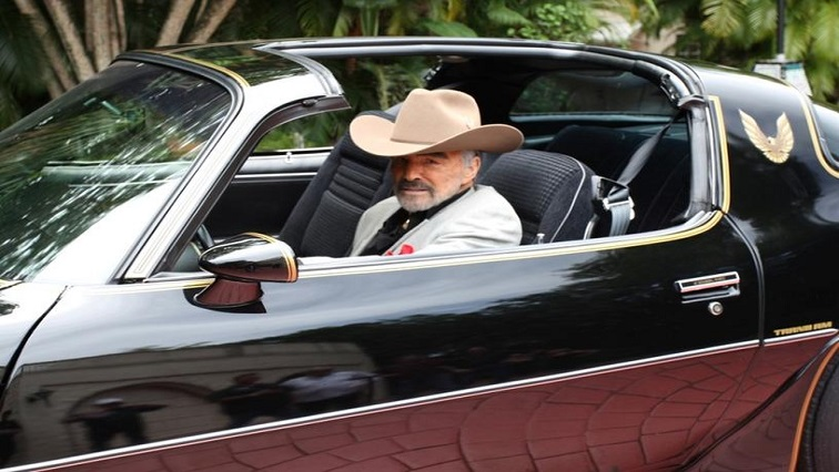 Burt Reynolds in his car
