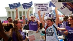 Women holding placards