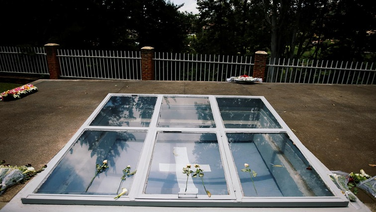 Flowers are seen on a grave site for victims of the Rwandan genocide at the Genocide Memorial