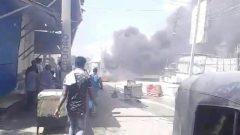 Debris burn on a street in Mogadishu,