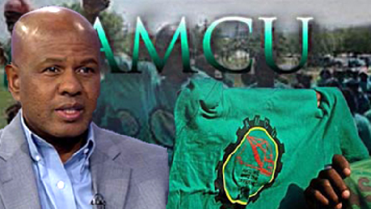 Jospeph Mathunjwa in front of the Amcu logo