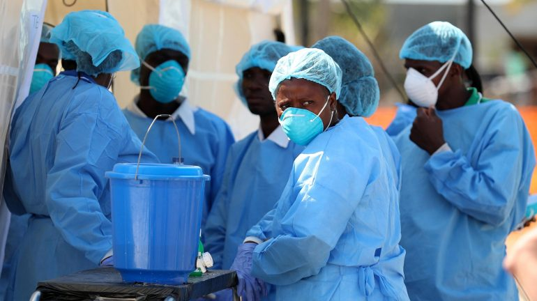 Medical staff attending to cholera patients