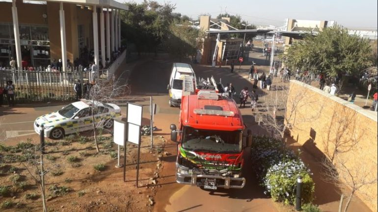 Firefighters outside the Bheki Mlangeni Hospital in Soweto.