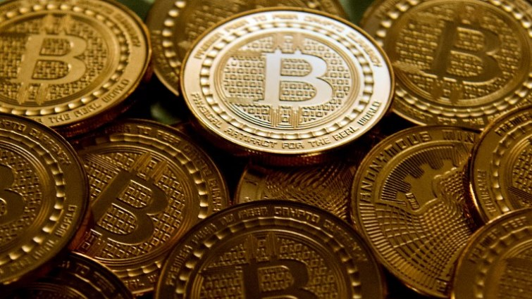 SABC News Bitcoin AFP - Bitcoin trades above $11 000, after 10% weekend jump