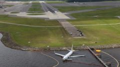 Aerial view of the Miami Air International Boeing 737-800 that overran the runway at NAS Jacksonville and came to rest in the St Johns River in Jacksonville.