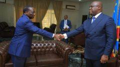 Sylvestre Ilunga Ilukamba shaking hands with Felix Tshisekedi