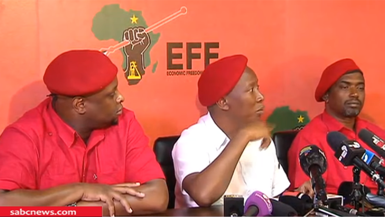 Julius Malema in the middle with white shirt