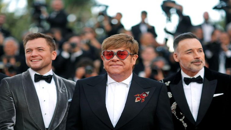 Elton John in the middle