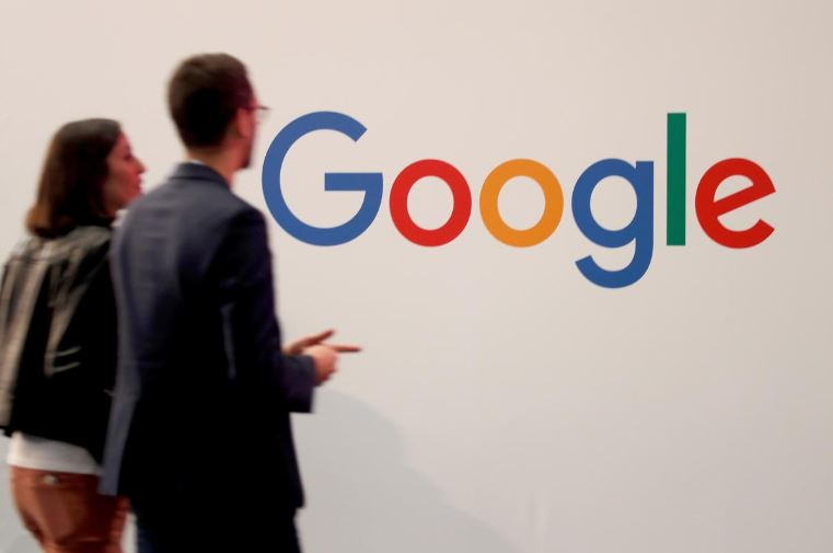 Visitors pass by the logo of Google at the high profile startups and high tech leaders gathering