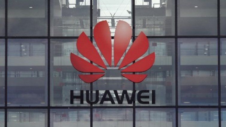 Huawei logo on a glass wall