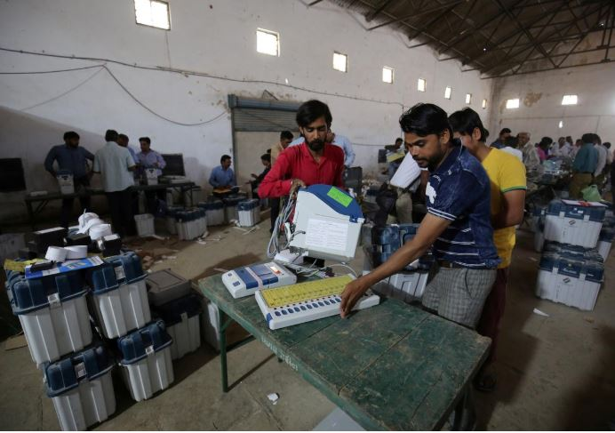 Election staff check Voter Verifiable Paper Audit Trail (VVPAT) machines and Electronic Voting Machines (EVM) ahead of India's general election at a warehouse in Ahmedabad.