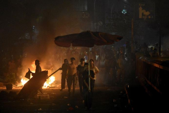 Protesters clash with the police in Jakarta, Indonesia, early May 22, 2019.