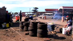 Township area with tyres on the side of the road