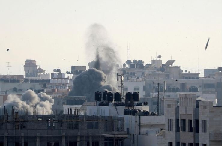A missile lands as smoke rises during an Israeli air strike in Gaza city.