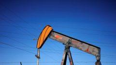 An oil well pump jack is seen at an oil field supply yard near Denver, Colorado.