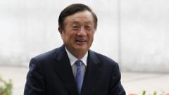 Huawei CEO and founder Ren Zhengfei walks inside Huawei's headquarters in the southern Chinese city of Shenzhen.