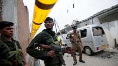 Security personnel seen at the site of an overnight gun battle, between troops and suspected Islamist militants.