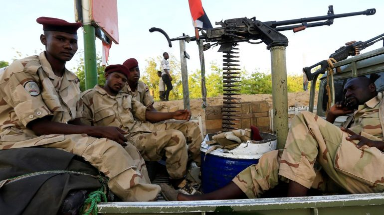 Sudanese military personnel are positioned near a bridge gate during a sit-in protest outside the Defence Ministry in Khartoum, Sudan.