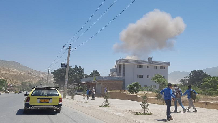 Smoke rises from the site of an attack in Pul-e-Khumri city.