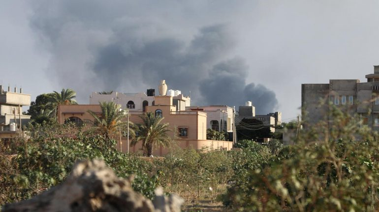 Smoke rises during heavy clashes between rival factions in Tripoli, Libya.