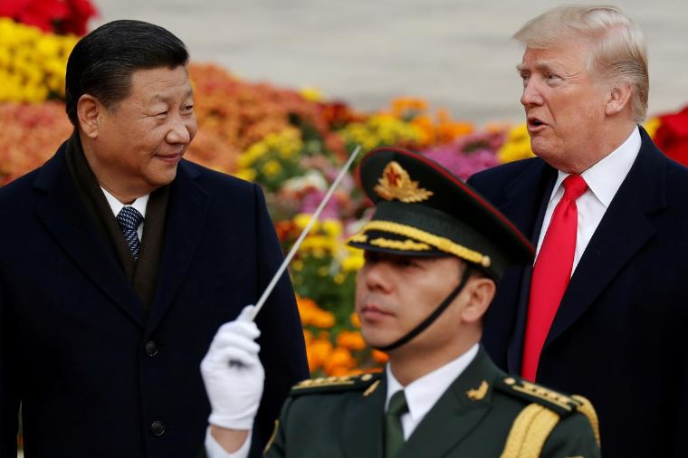 US President Donald Trump takes part in a welcoming ceremony with China's President Xi Jinping at the Great Hall of the People in Beijing.
