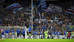 Sampdoria players celebrate in front of their fans after the match
