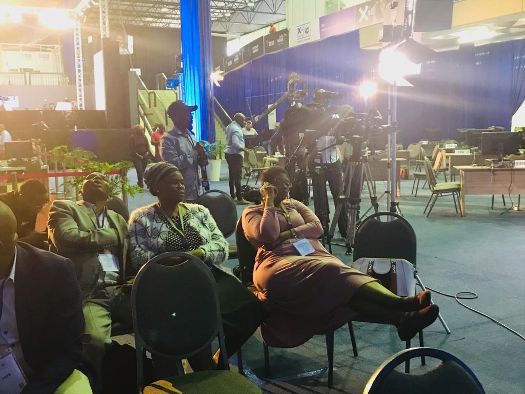 People sitting during a briefing of the IEC