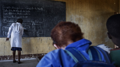 Child with albinism sitting in front of class to see clearly